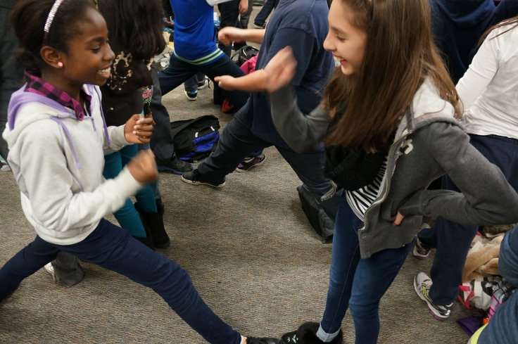 Students learn the new way to play Rock, Paper, Scissors...Splits!