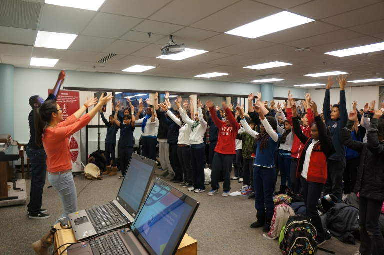 E-CSLIT Chair, Theresa Hoang and Co-op student, Stefan Ntansah lead the students in a Waving Flag dance.