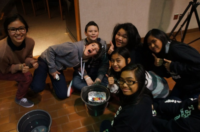 E-CSLIT Chair, Theresa Hoang checks in with St. Rose of Lima to see how their boat is doing.
