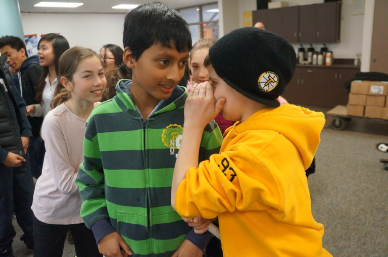 "Students play the icebreaker ""Monkey Business."""