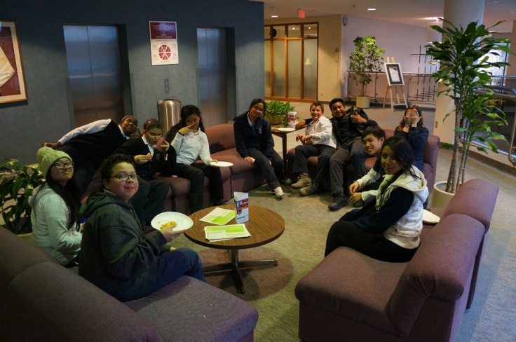 E-CSLIT members chilling by the couches and enjoying their pizza dinner.