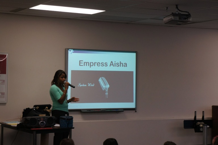 Former student of Michael Consul, Empress Aisha presents her spoken word.