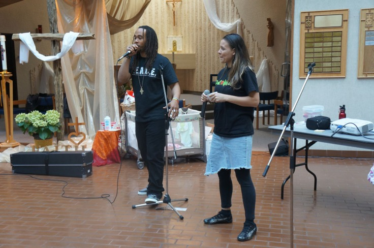 Tanika and Testament from P.E.A.C.E. (People Everywhere Actually Co-existing Equally) giving a motivational talk...
