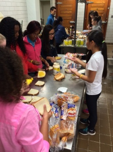Students work together to ensure that the sandwiches are made the best/right way. (Leave a comment about your experience.)