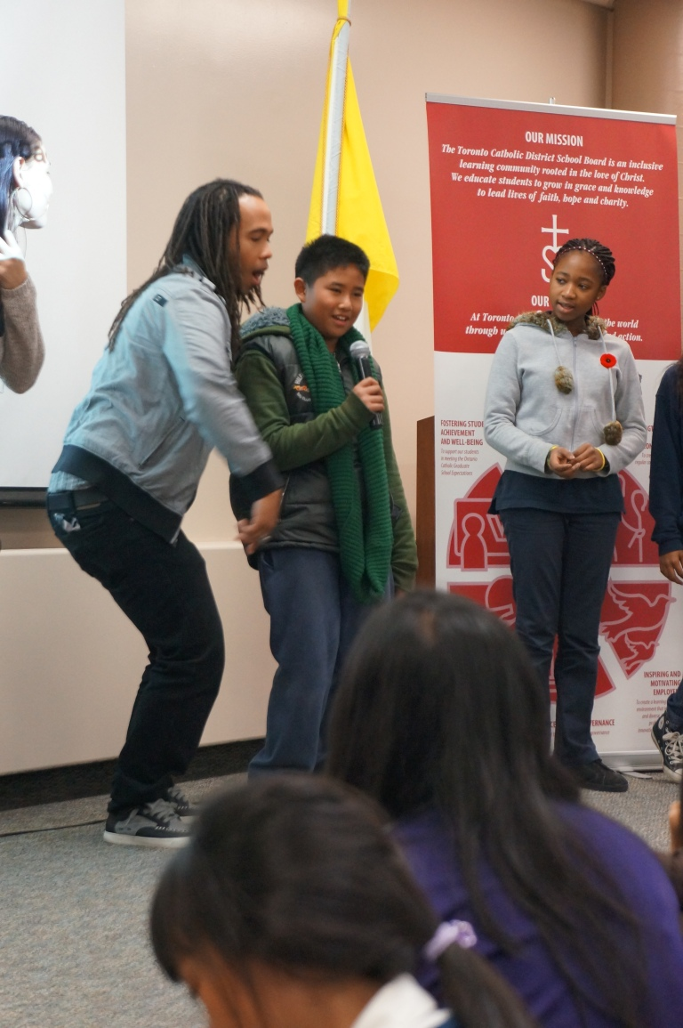 Tanika and Tesmod get two volunteers to rap with them.