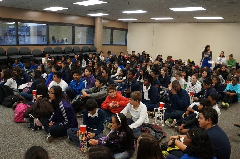 Elementary student leaders waiting patiently for the meeting to begin.