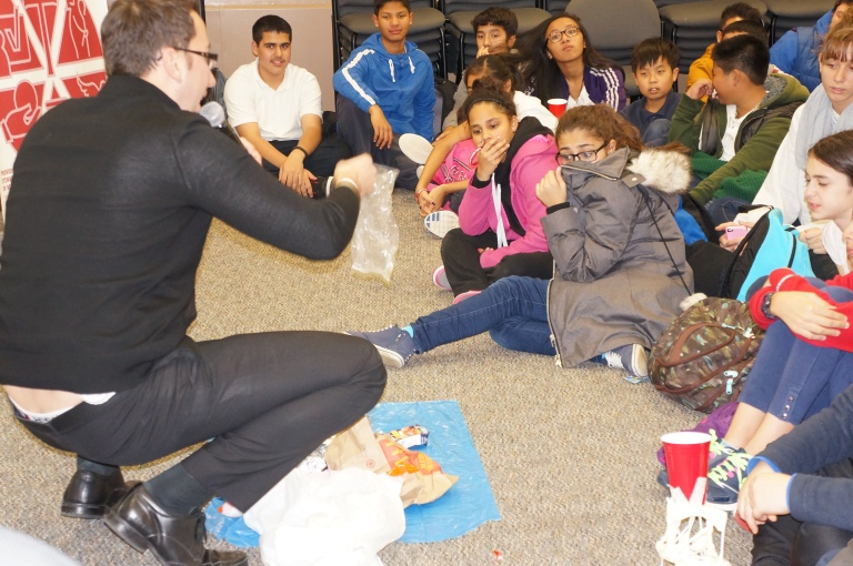 Brian Meli shows the students the garbage he picked up!