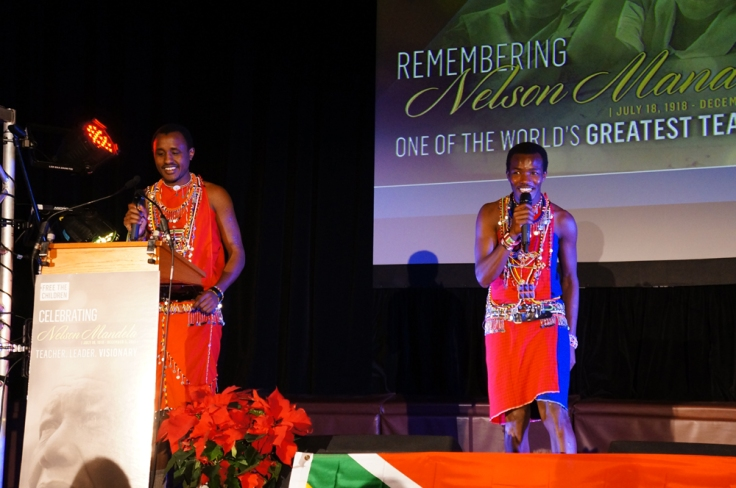 Two Kenyan Maasai Warriors take the stage.