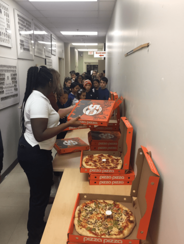 Pizza Pizza time! Afterwards the newspaper chair challenge took place upstairs, outside the board room.